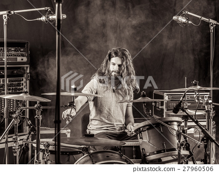 Man with long hair playing drums 27960506