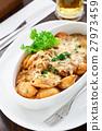 Dumplings with mushroom sauce 27973459