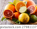 Assorted fresh citrus fruits. 27981137