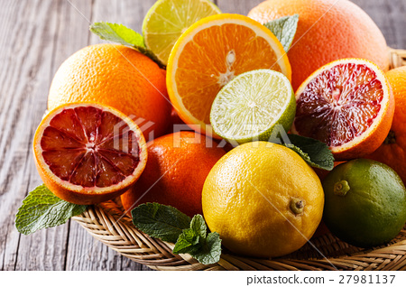 Assorted fresh citrus fruits. 27981137