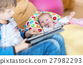 Preschool kid boy playing games tablet computer 27982293