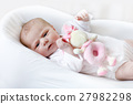 Cute baby girl playing with plush animal toy 27982298