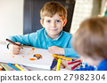 Two little kid boys at school painting a story 27982304