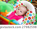 Cute adorable newborn baby playing on colorful toy 27982598