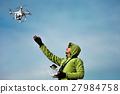 Man operating a drone 27984758