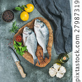 Uncooked sea bream fish with lemon, herbs, spices 27987319