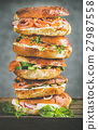 Heap of Bagels with salmon, eggs, vegetables 27987558