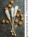 Crystallized sugar on wooden stick. 27990699