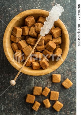 Crystallized sugar on wooden stick. 27990700