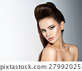 Young beautiful  woman with stylish hairstyle 27992025