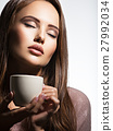 Woman with cup of coffee 27992034