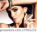 beautiful woman with evening make-up jewelry 27992235