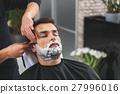 Professional hairdresser shaving beard of customer 27996016