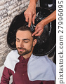 Happy guy getting hairwash at beauty salon 27996095
