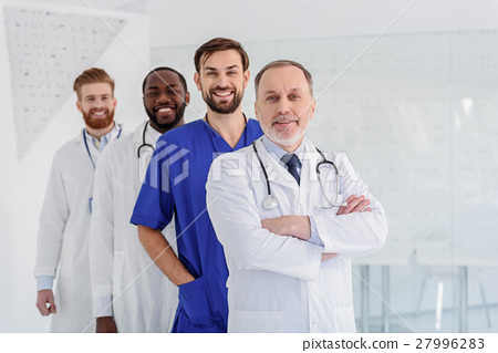 Happy doctors working with enjoyment 27996283
