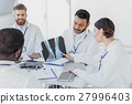 Professional general practitioners discussing 27996403