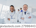 Happy medical team working in clinic 27996443