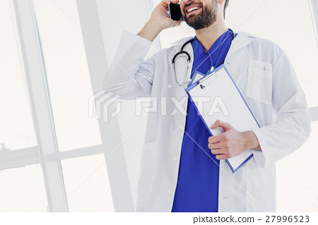 Excited young doctor talking with patient by 27996523
