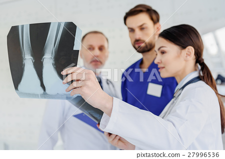 Skillful doctors analyzing x-ray photo 27996536