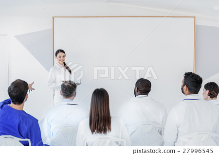 Joyful general practitioner having conversation 27996545