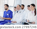 Cheerful medical team listening to new information 27997246