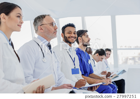Professional doctors making notes with interest 27997251