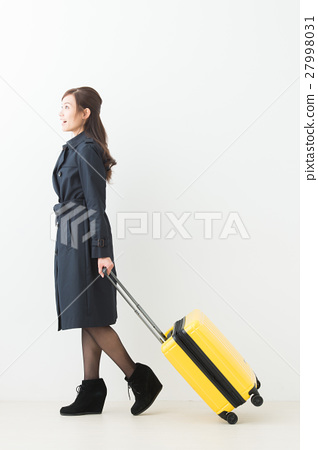 A woman with a suitcase 27998031