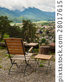 Rustic armchair and peaceful mountain view 28017615