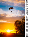 Skydiver On Colorful Parachute In Sunny Sky 28017699