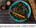 Wakame salad, raw seaweed, Japanese cuisine. 28033067