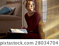 A woman reading 28034704