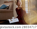 A woman reading 28034717
