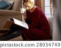 A woman reading 28034749