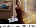 A woman reading 28034766