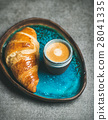 Cup of espresso coffee and croissant in blue 28041335