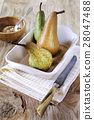 Three pears in baking dish, sugar and knife 28047488