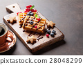 Coffee, sweets and waffles with berries 28048299