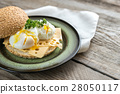 Sandwich with poached eggs 28050117