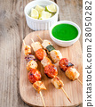 Grilled chicken skewers with zucchini  28050282