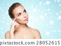 beautiful young woman touching her face over snow 28052615