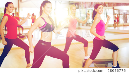 group of smiling people doing aerobics 28056776