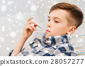 ill boy with flu and thermometer at home 28057277