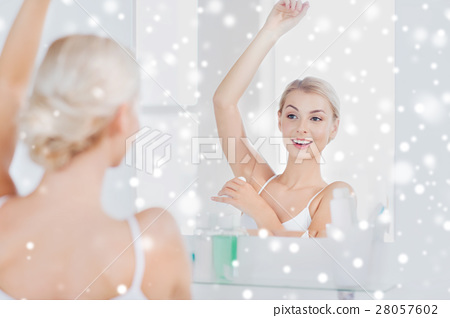 woman with antiperspirant deodorant at bathroom 28057602