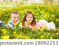 Girl lying with the boy 28062253