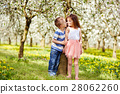 Boy and a girl in orchard 28062260