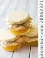 Orange marmalade on white table 28062321