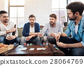 Good looking male friends playing poker 28064769