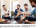 Cheerful pleasant men playing the poker game 28064777