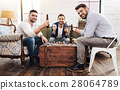Cheerful positive men playing card games 28064789