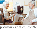Male and female artists painting together 28065197